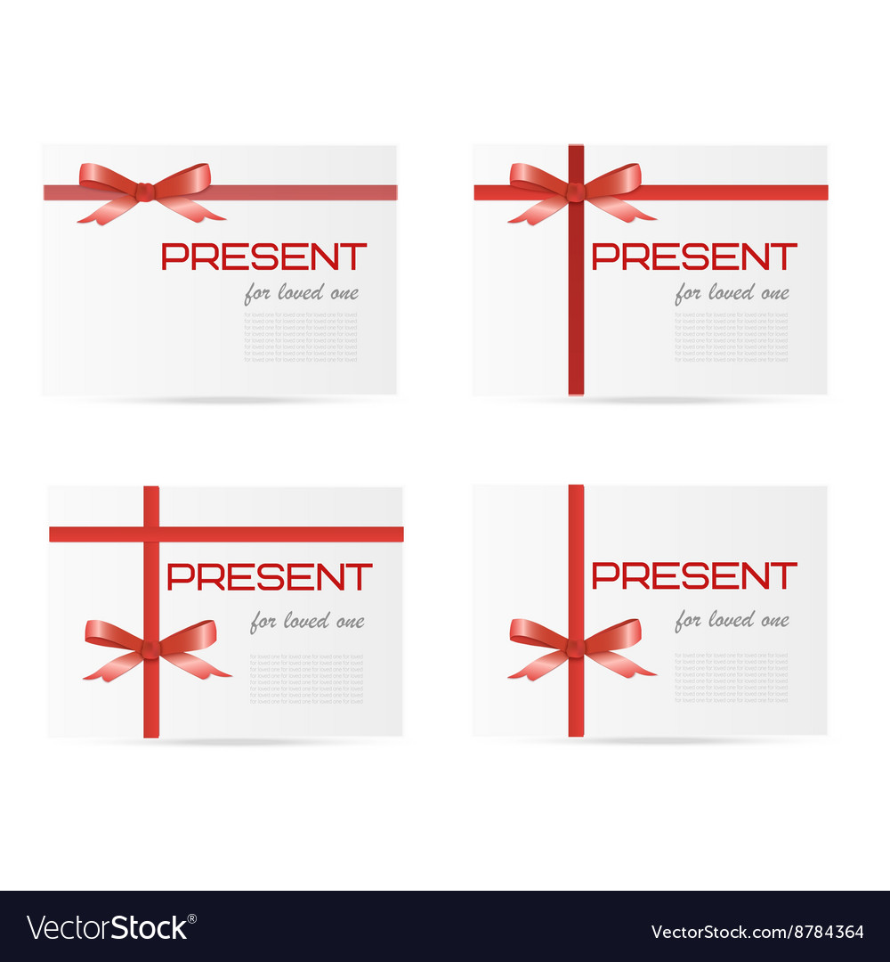Set of white gift boxes tied with red ribbons and