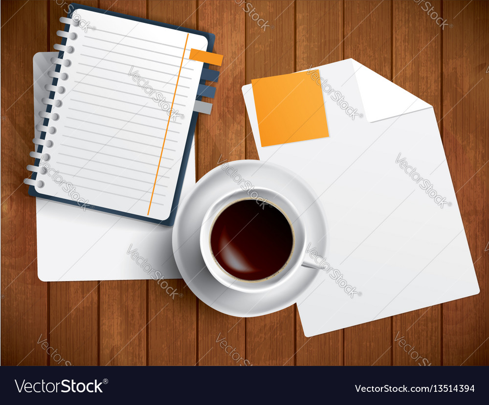 Coffee notebook and paper on wooden table