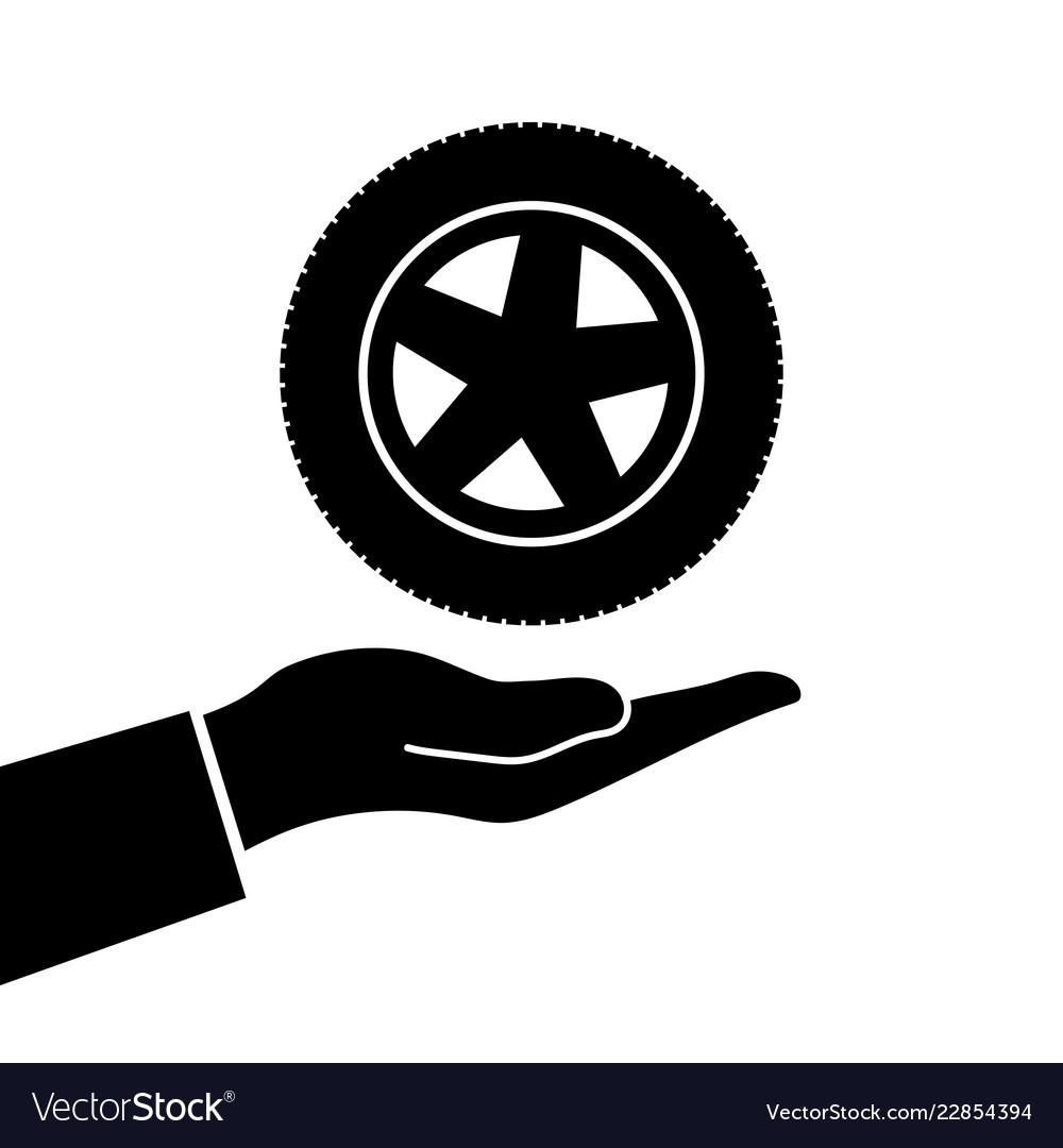 Hand holds wheel