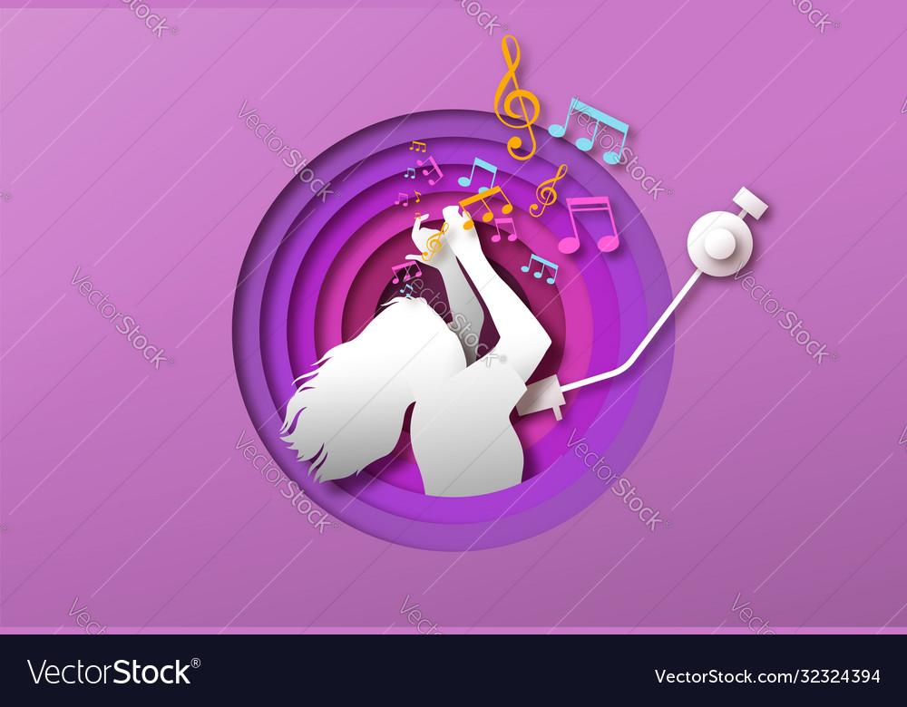 Woman dancing to music in papercut vinyl player