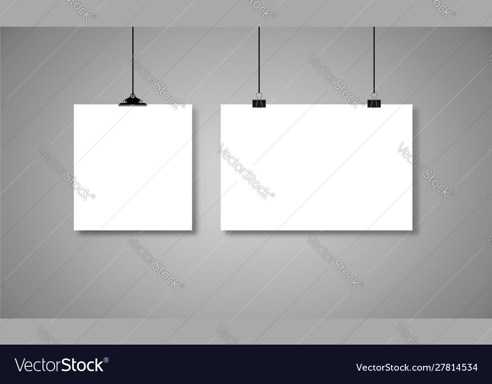 White paper hanging on binders with black rope