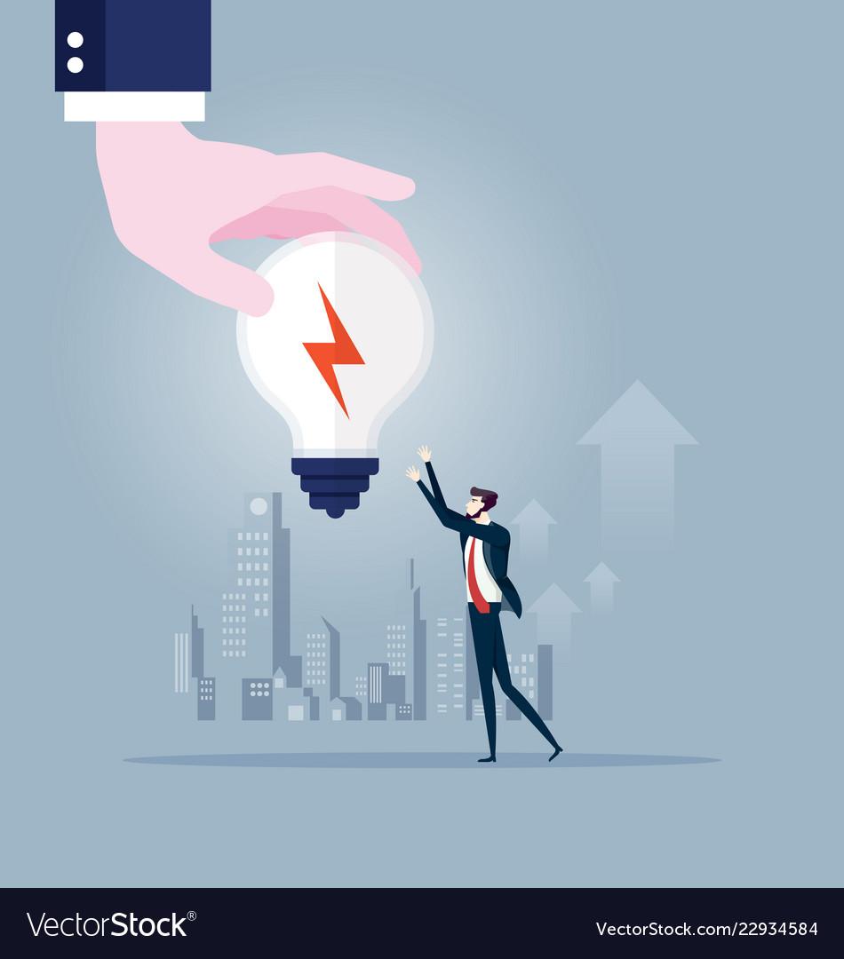 Big hand gives idea light bulb to businessman