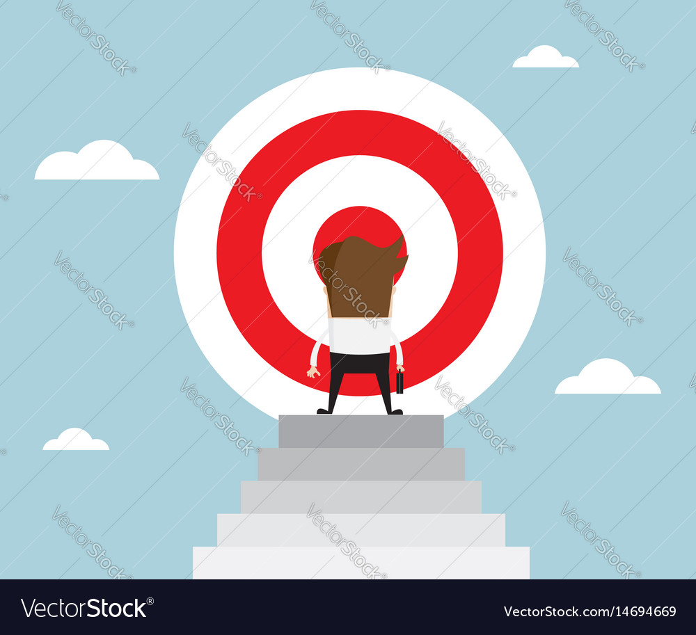 Businessman standing in front of big target