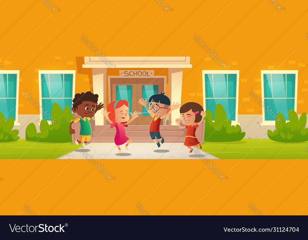 Happy children in front school building