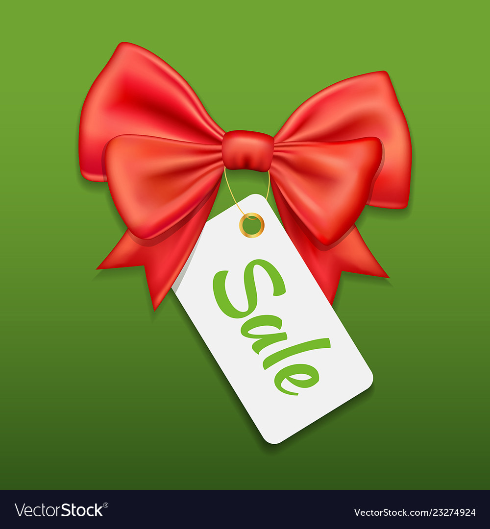 Red bow ribbon and tag sale on green