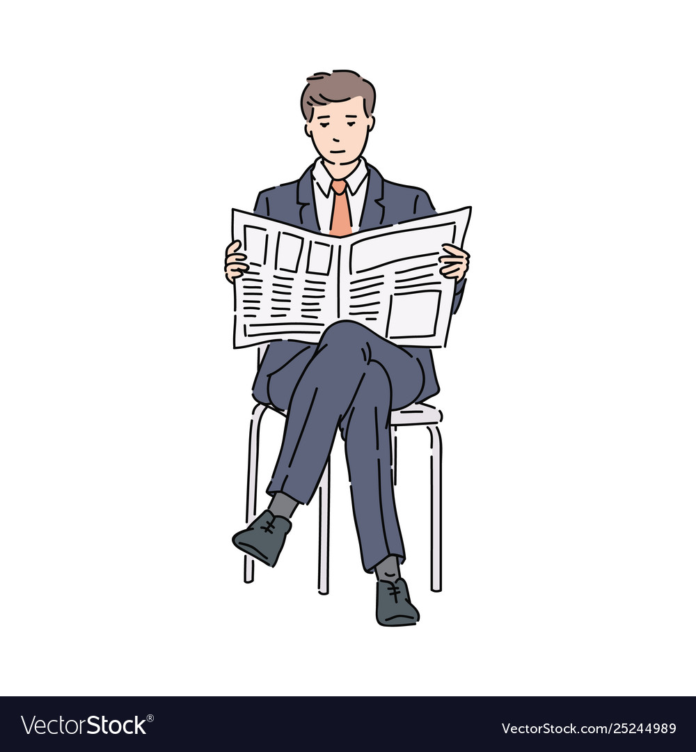 Businessman in suit sitting reading newspaper