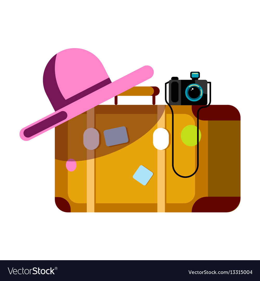 Suitcase with pink hat and photo camera isolated