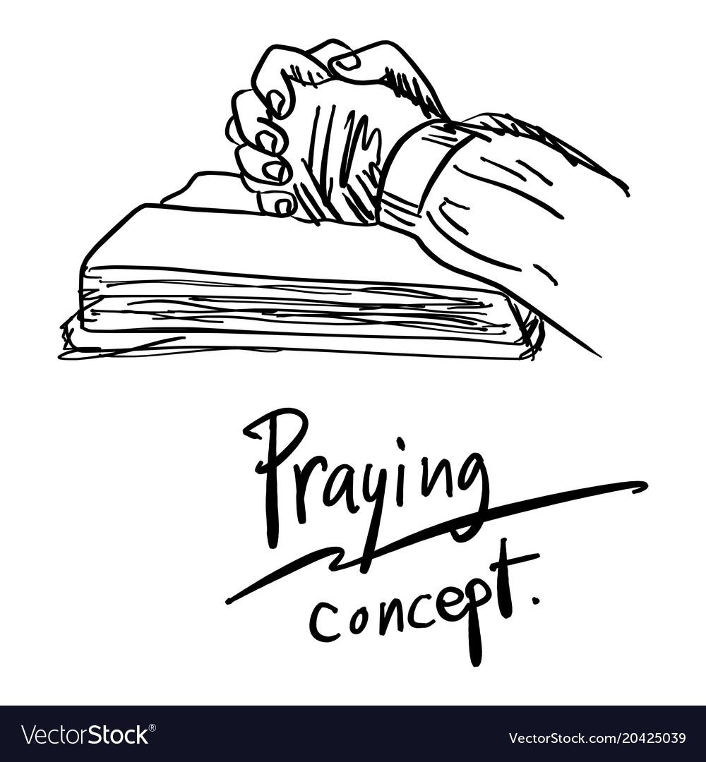 Close-up hand praying on bible