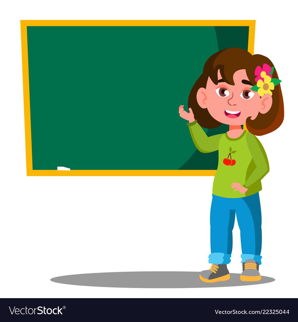 Schoolgirl standing near a school board in the