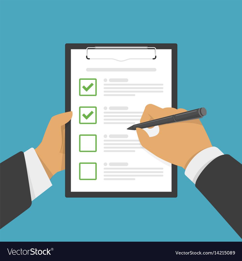 Hand filing checklist on clipboard