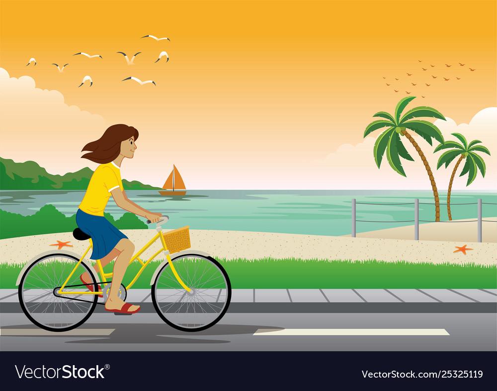 Girl riding bicycle at beach