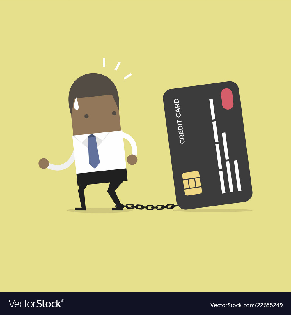 Businessman with foot chained to bank credit card