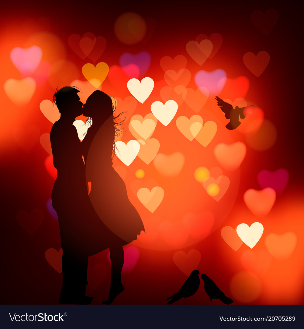 Silhouette of a couple in love kissing against a