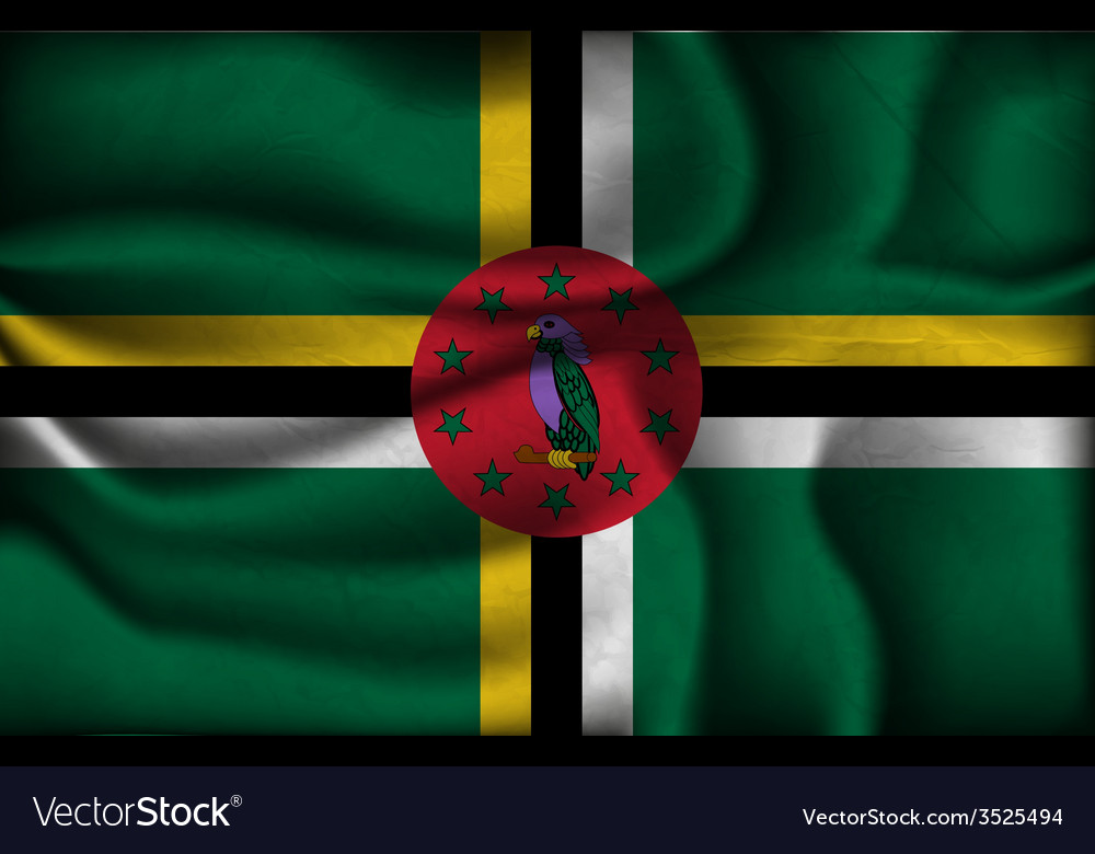 Crumpled flag of Dominica on a light background