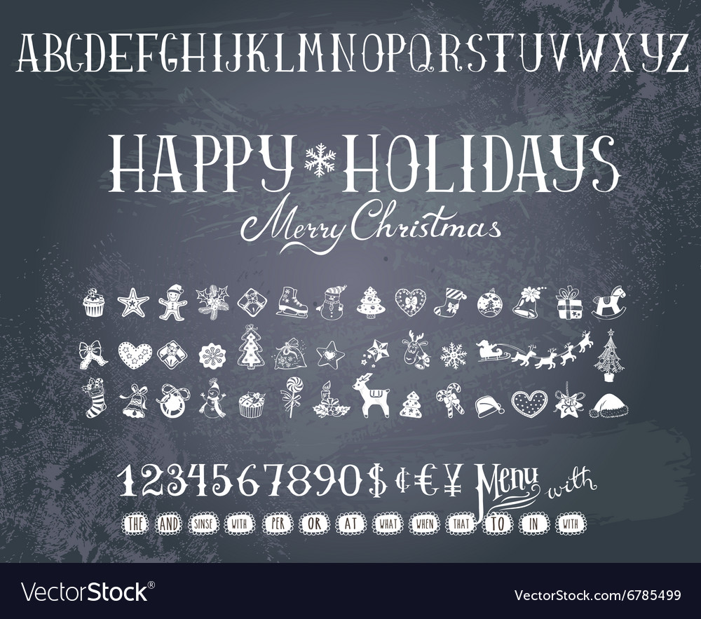 Holiday decorations and alphabet on a blackboard