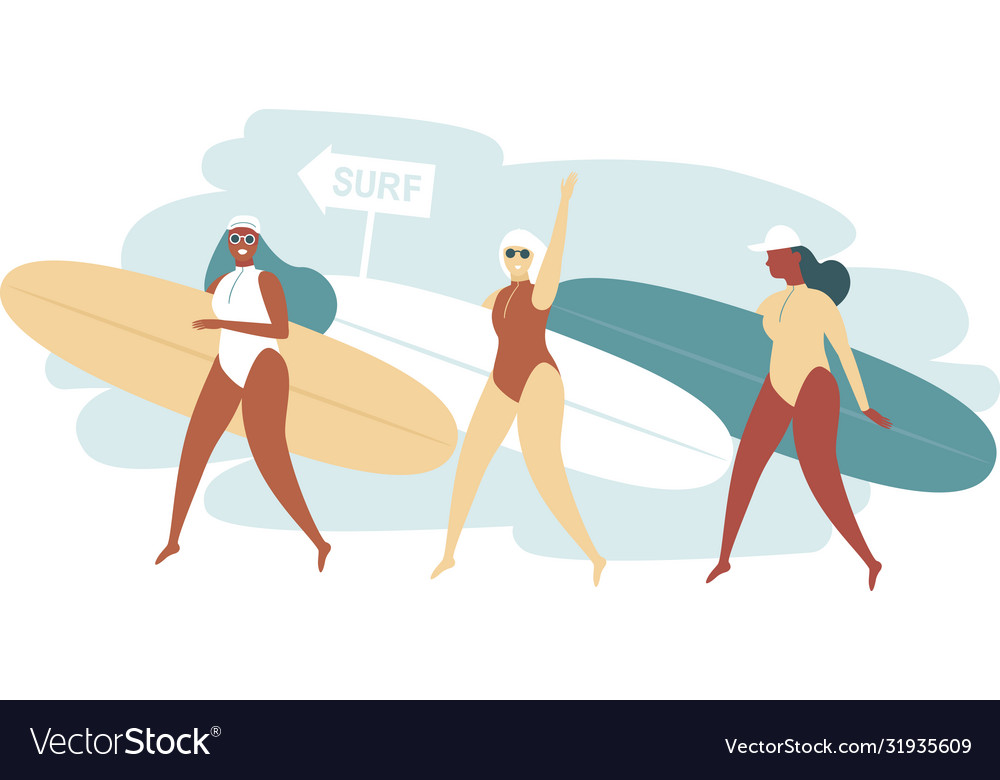 Three surfer girls walking with boards