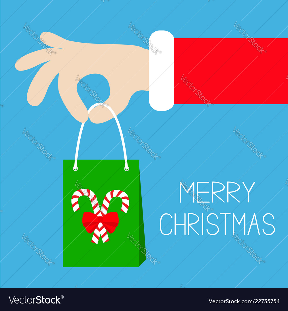 Merry christmas santa claus hand holding gift