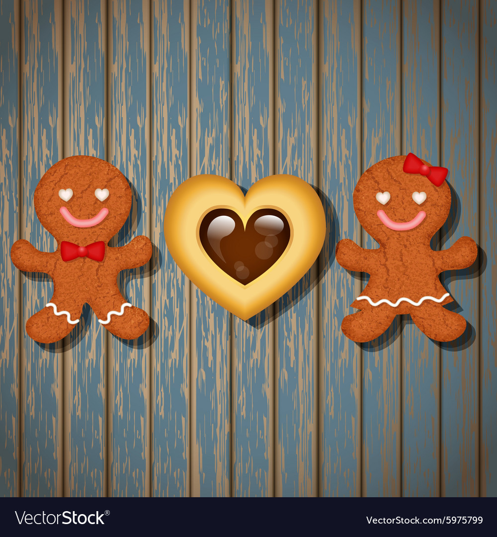Loving Couple Of Gingerbread And Heart Cookie