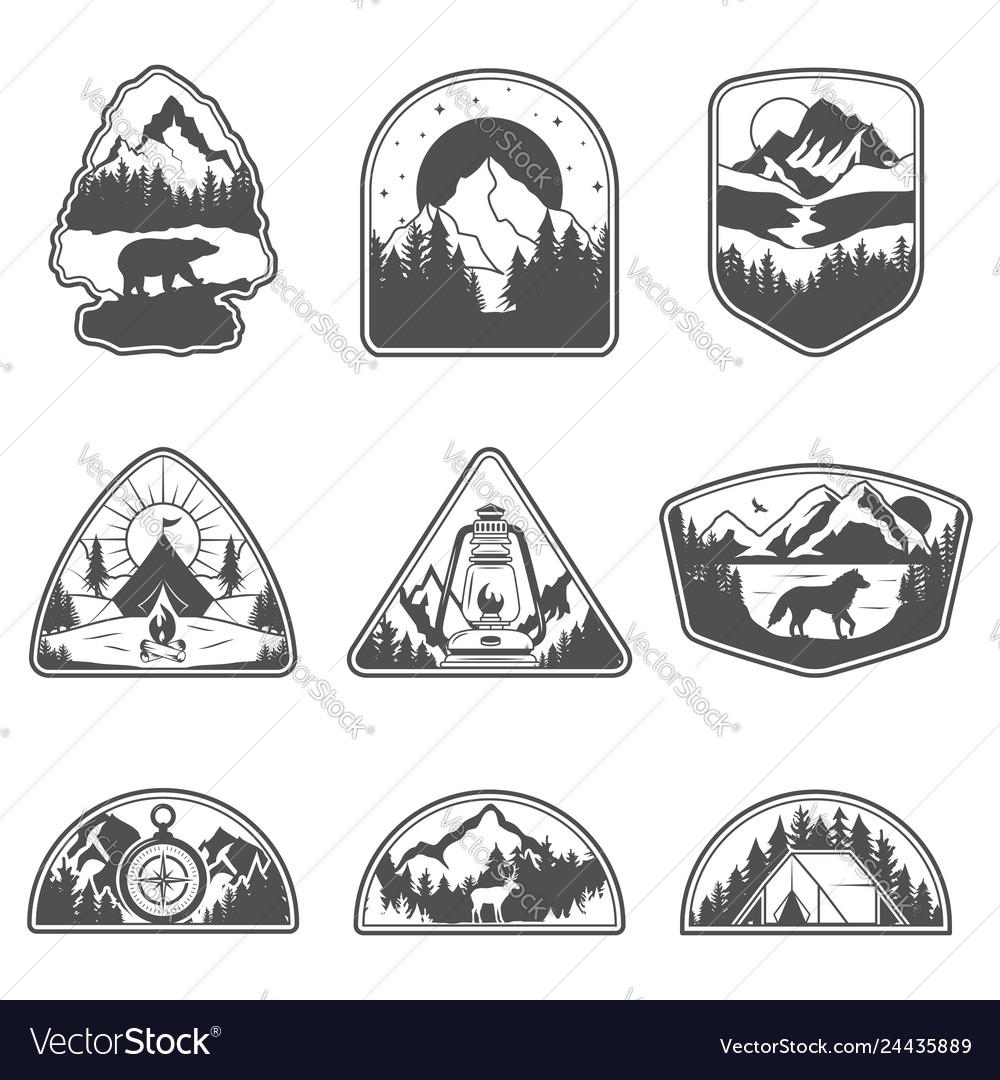 Set of nine mountain black travel emblems camping