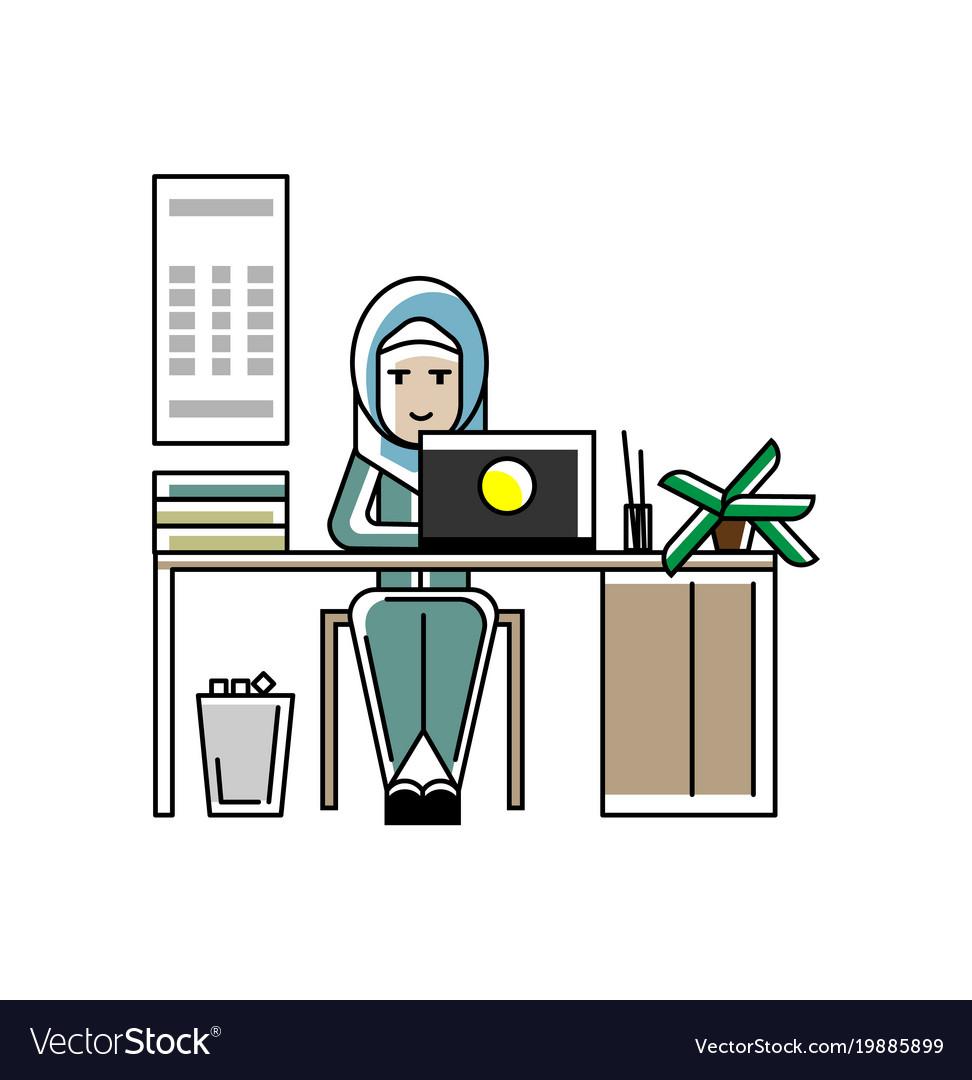 Arabic secretary working at laptop in office
