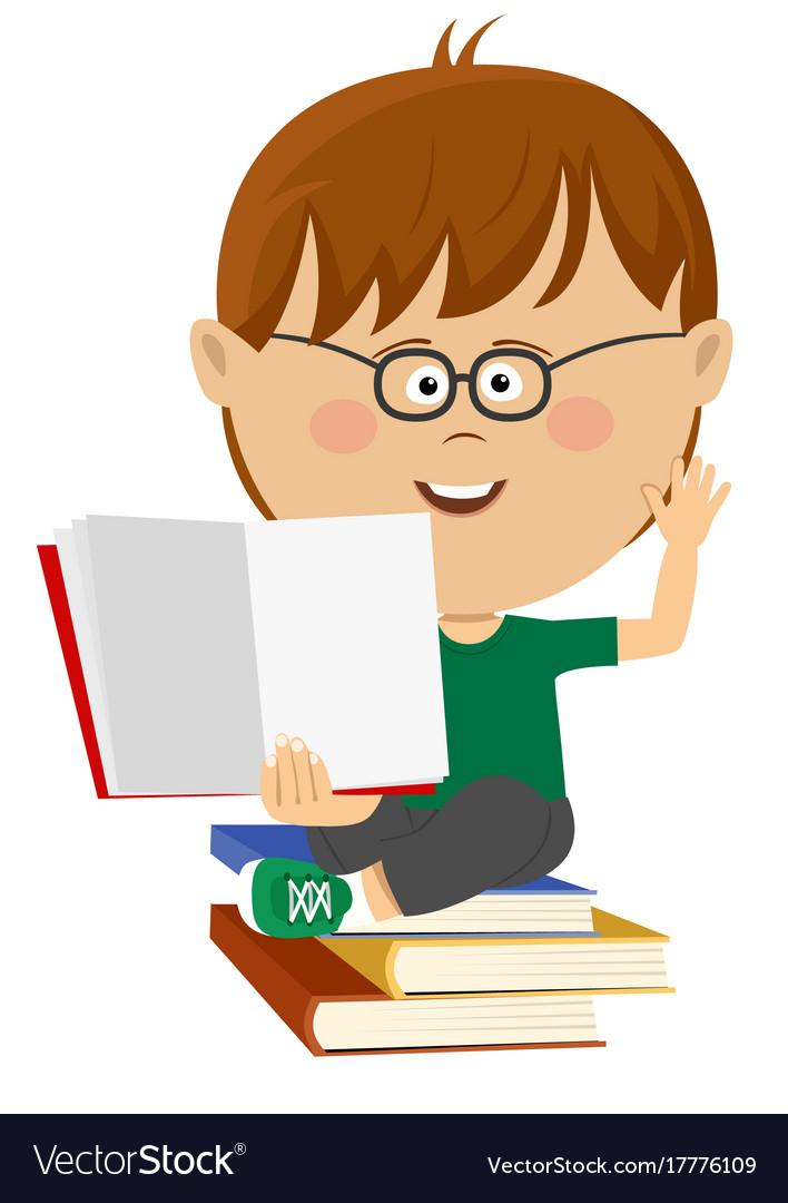 Cute nerd little boy shows open textbook