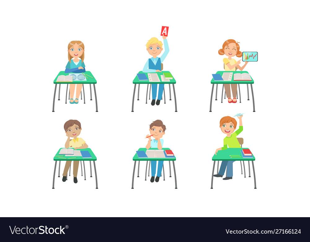 Primary schools pupils sitting at desks at