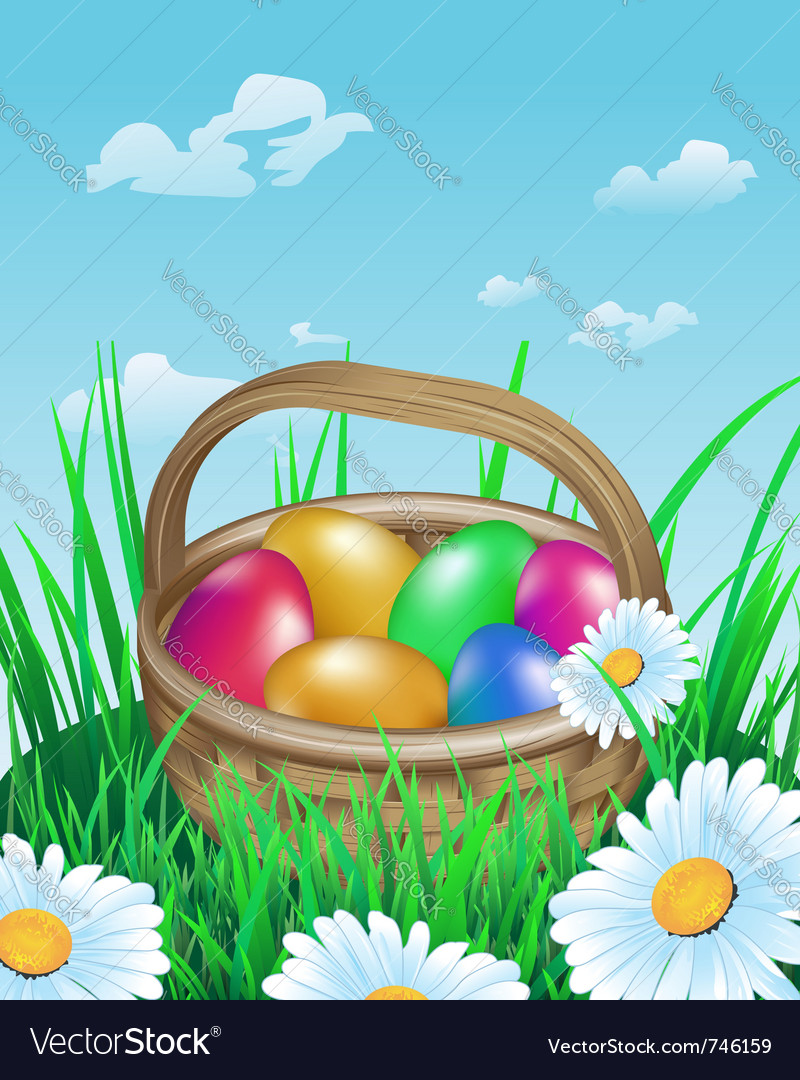 Colorful easter eggs in basket on meadow