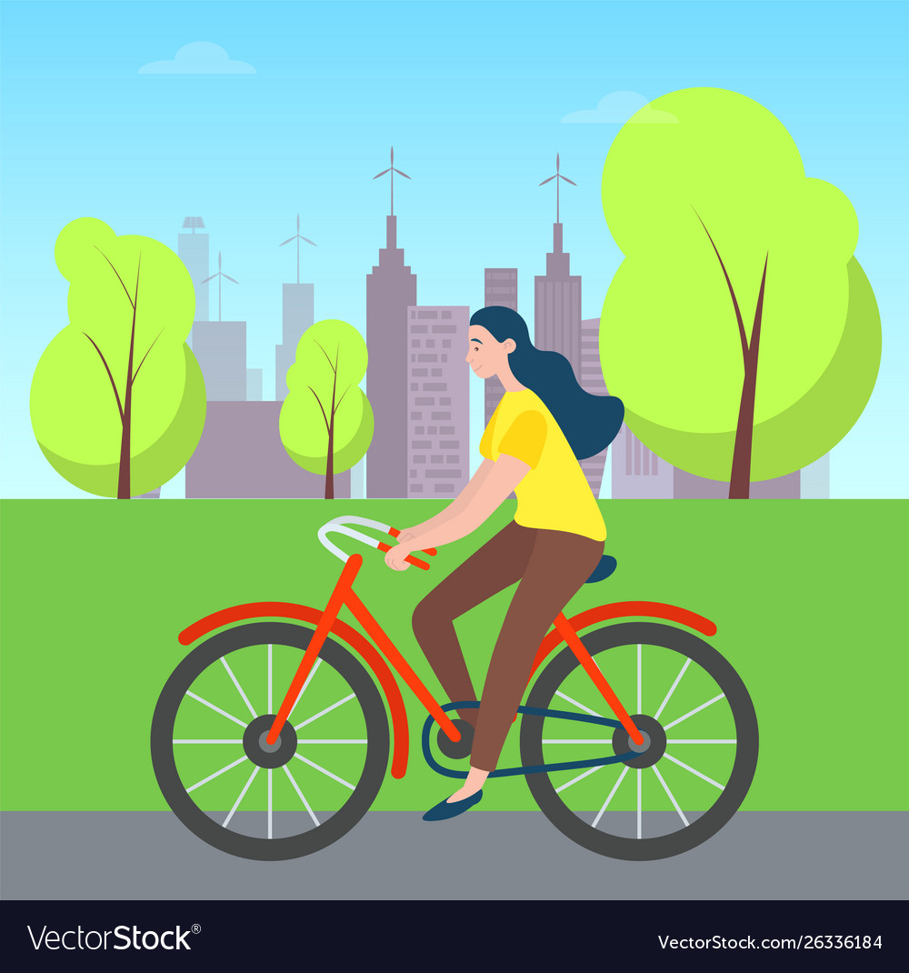 Woman riding on bicycle in green city park trees