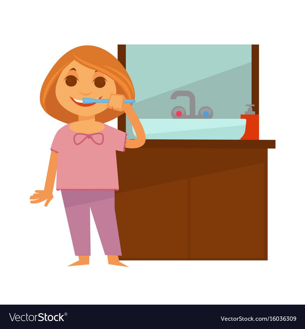 Little redhead girl brushes her teeth near