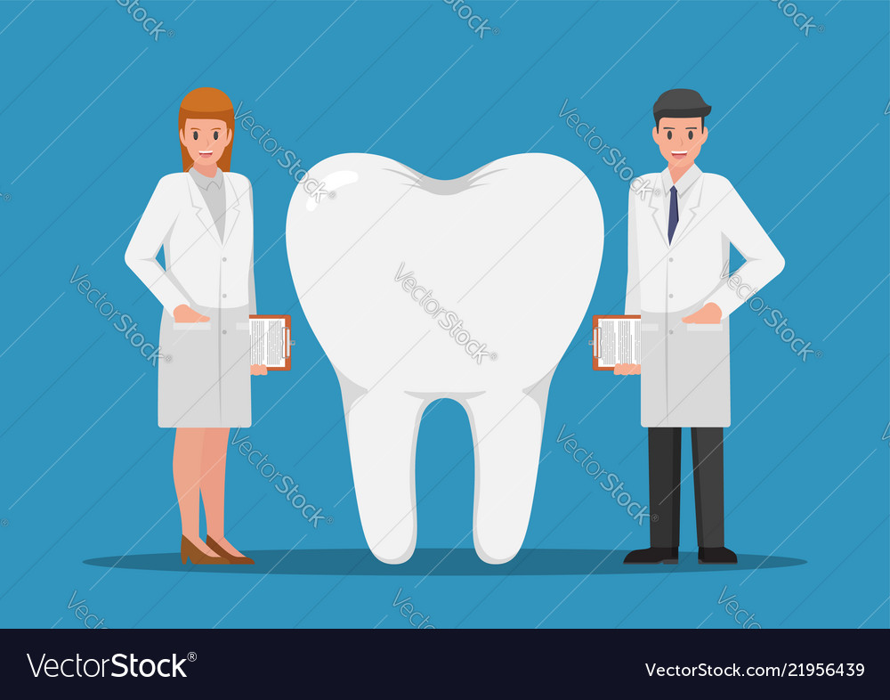 Male and female dentist standing with big tooth