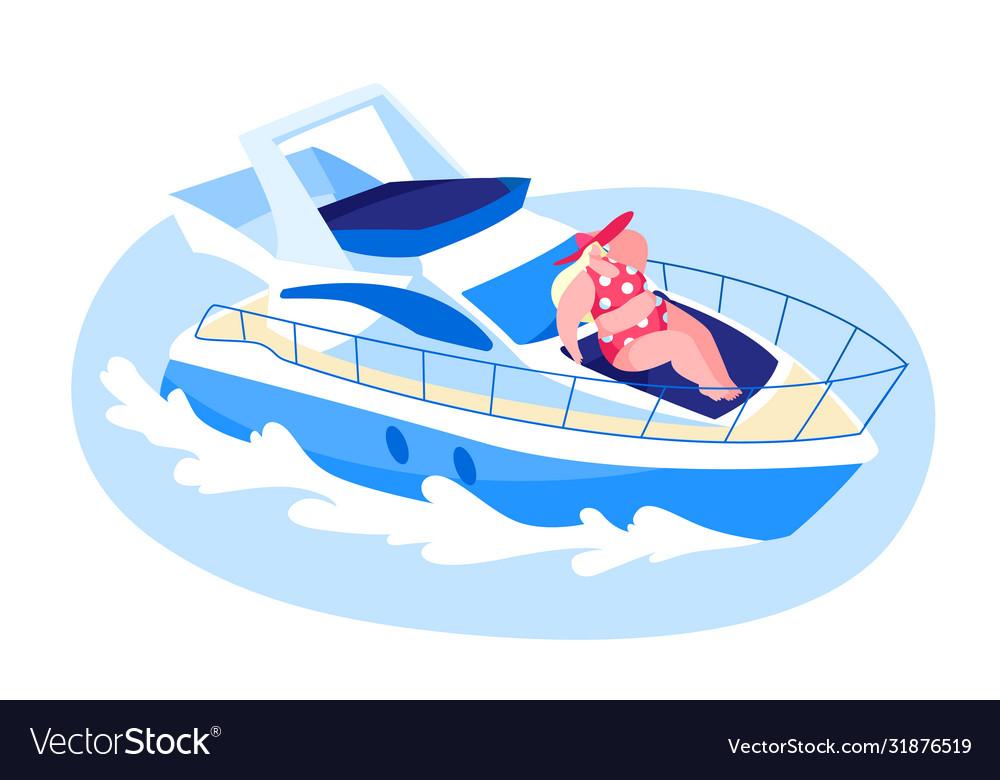Happy woman lying on ship deck and take sun