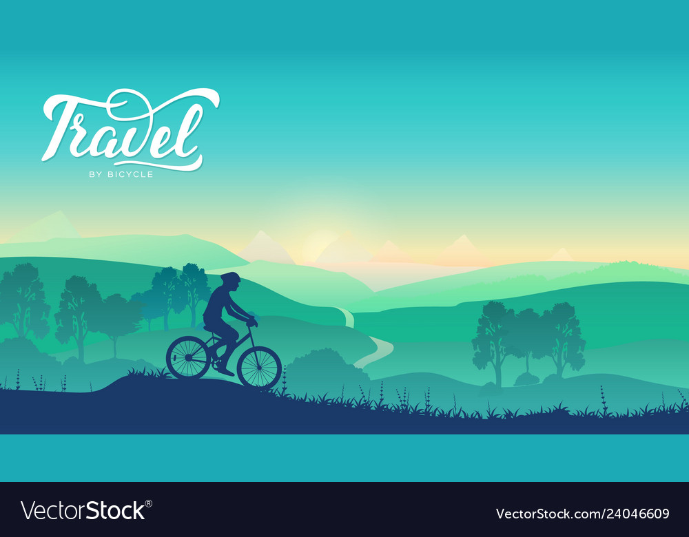 Cyclist rides on the trail in nature background