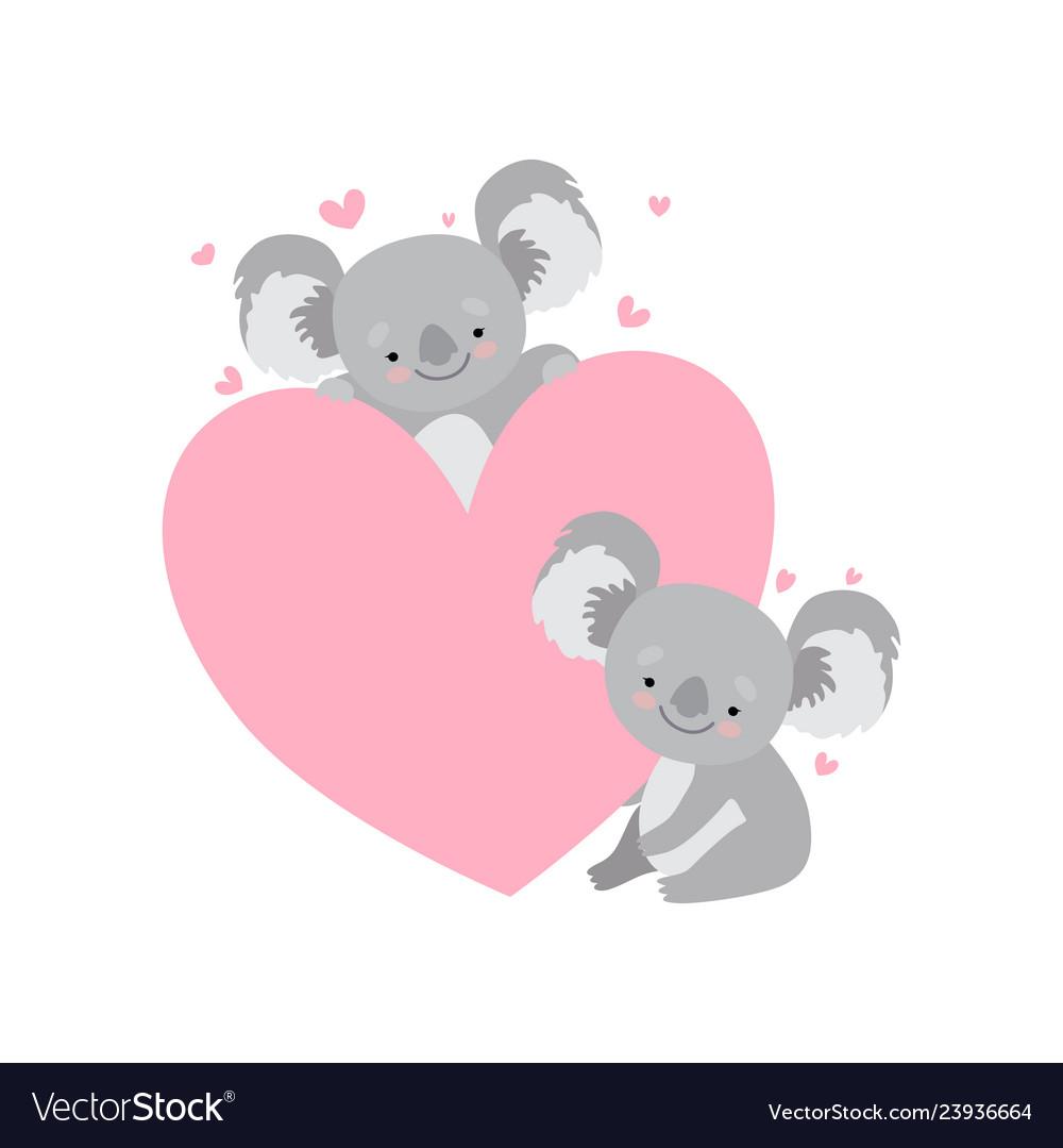 Two cute baby koala bears with big pink heart