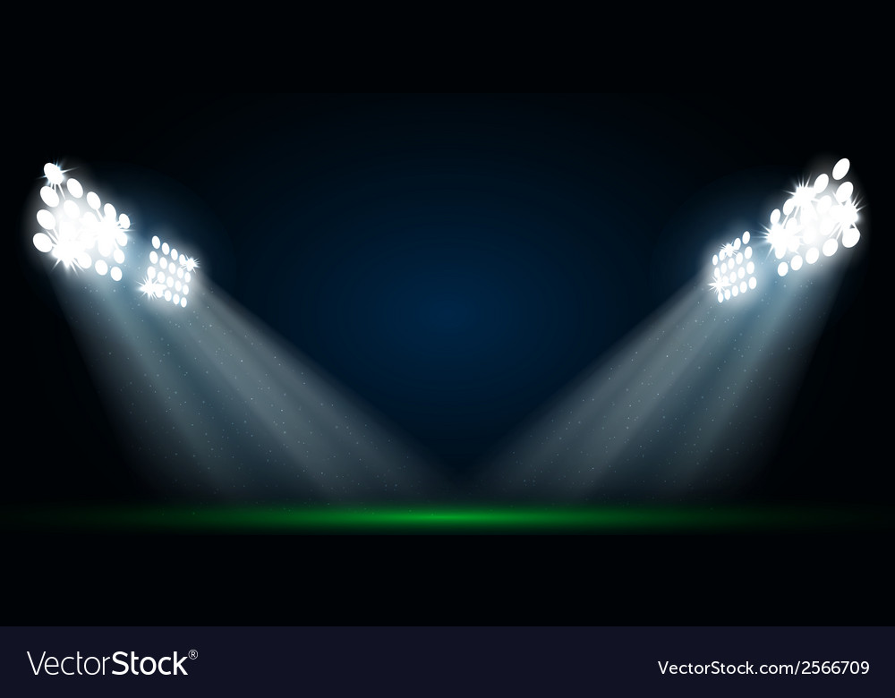 Four spotlights on a football field