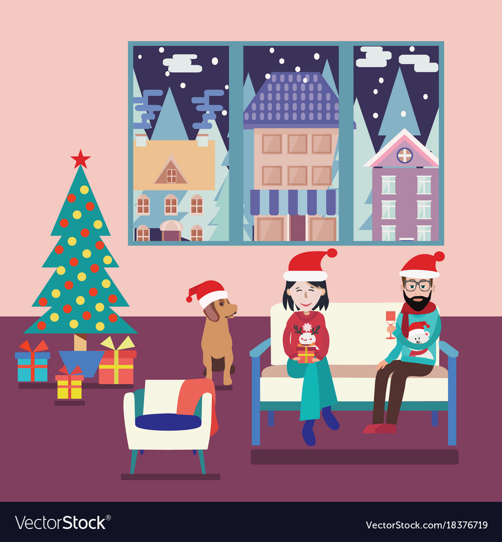 Couple at home sitting on sofa in the christmas