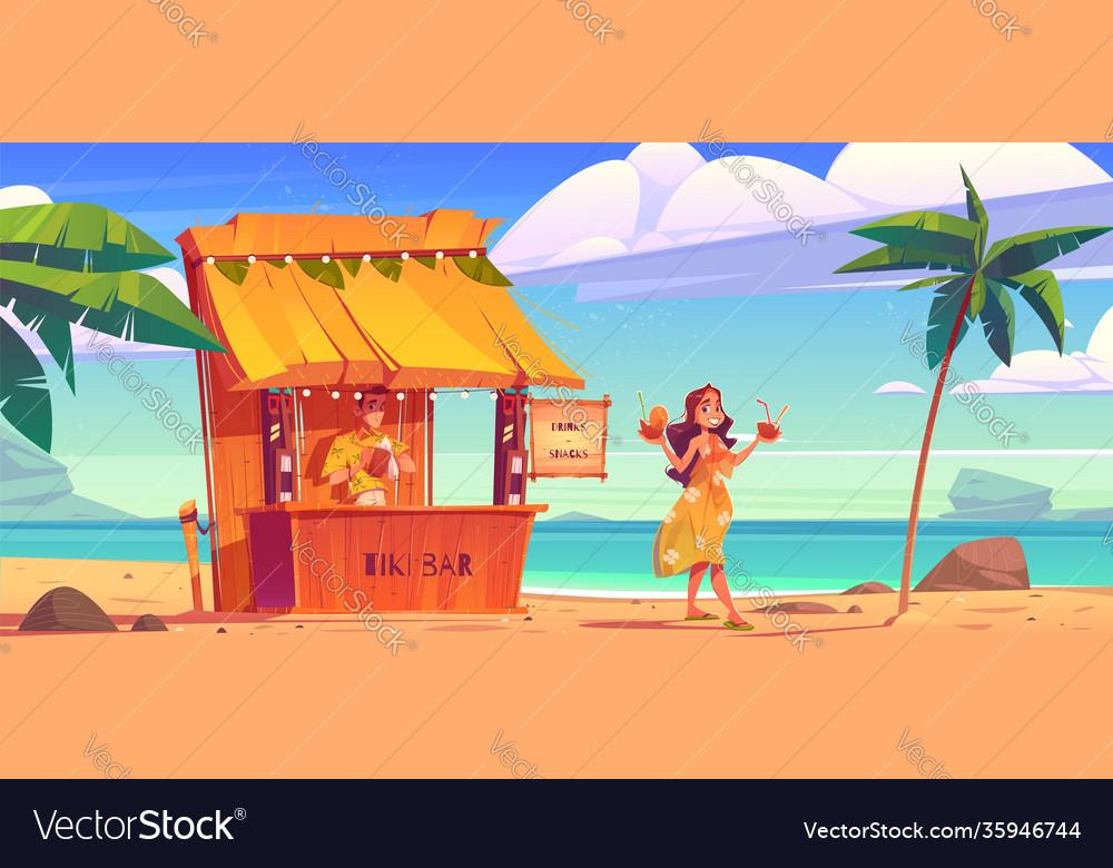 Woman buying cocktail in tiki hut bar with barman