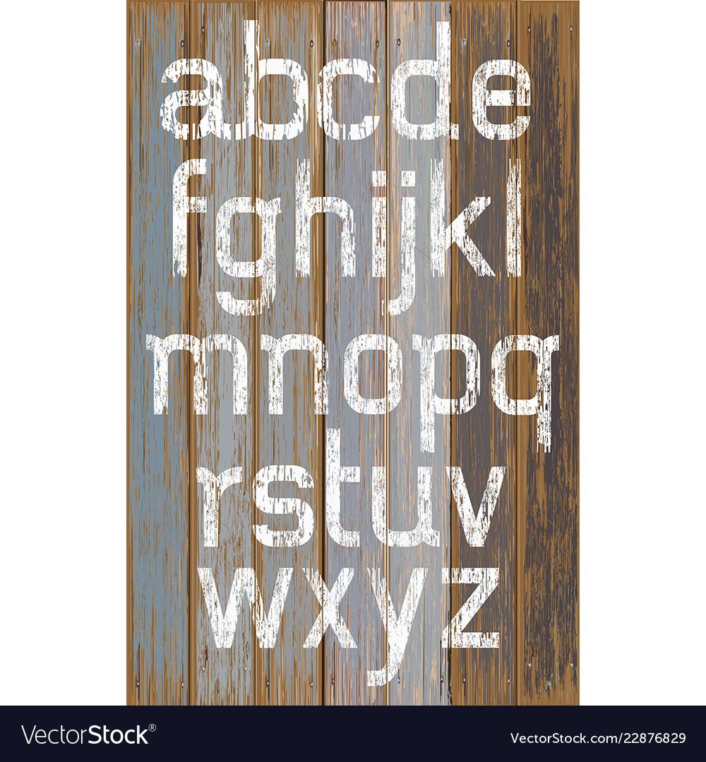Alphabet white color paint on wood retro color