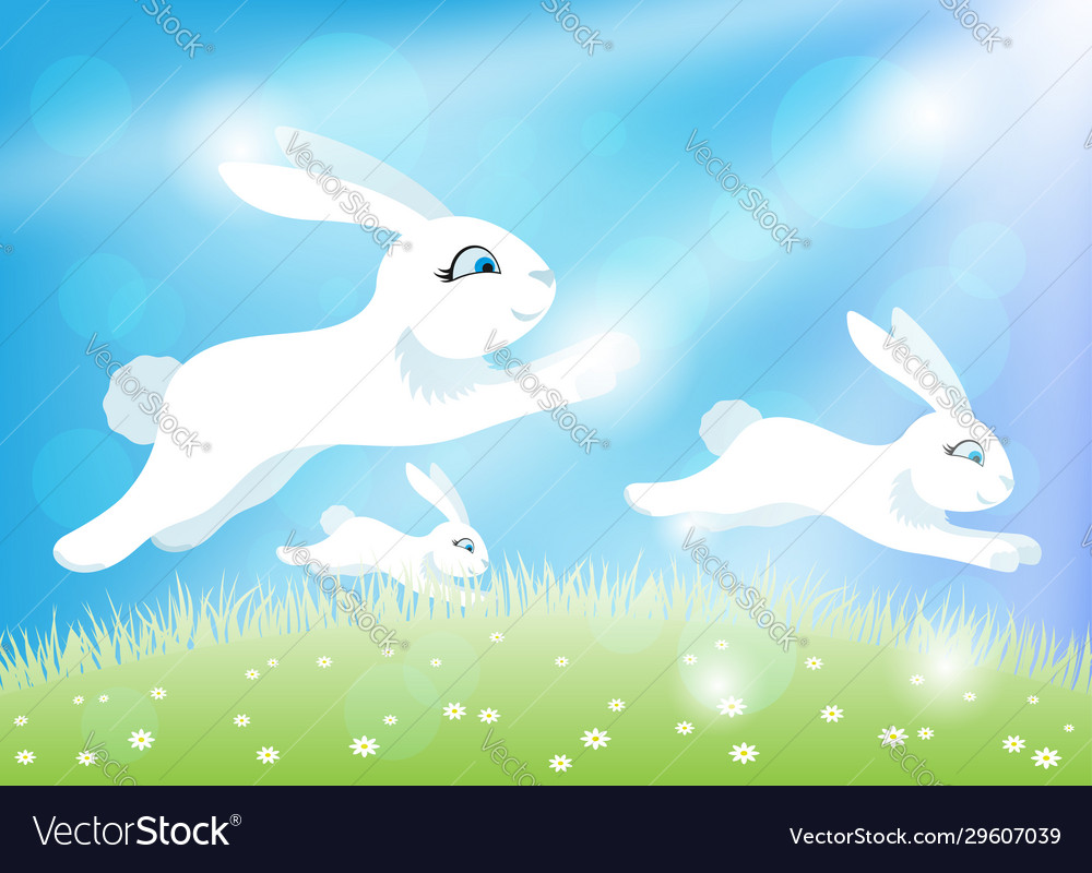 White easter bunnies on a green meadow