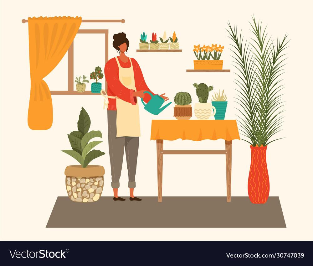 Young woman watering houseplants isolated