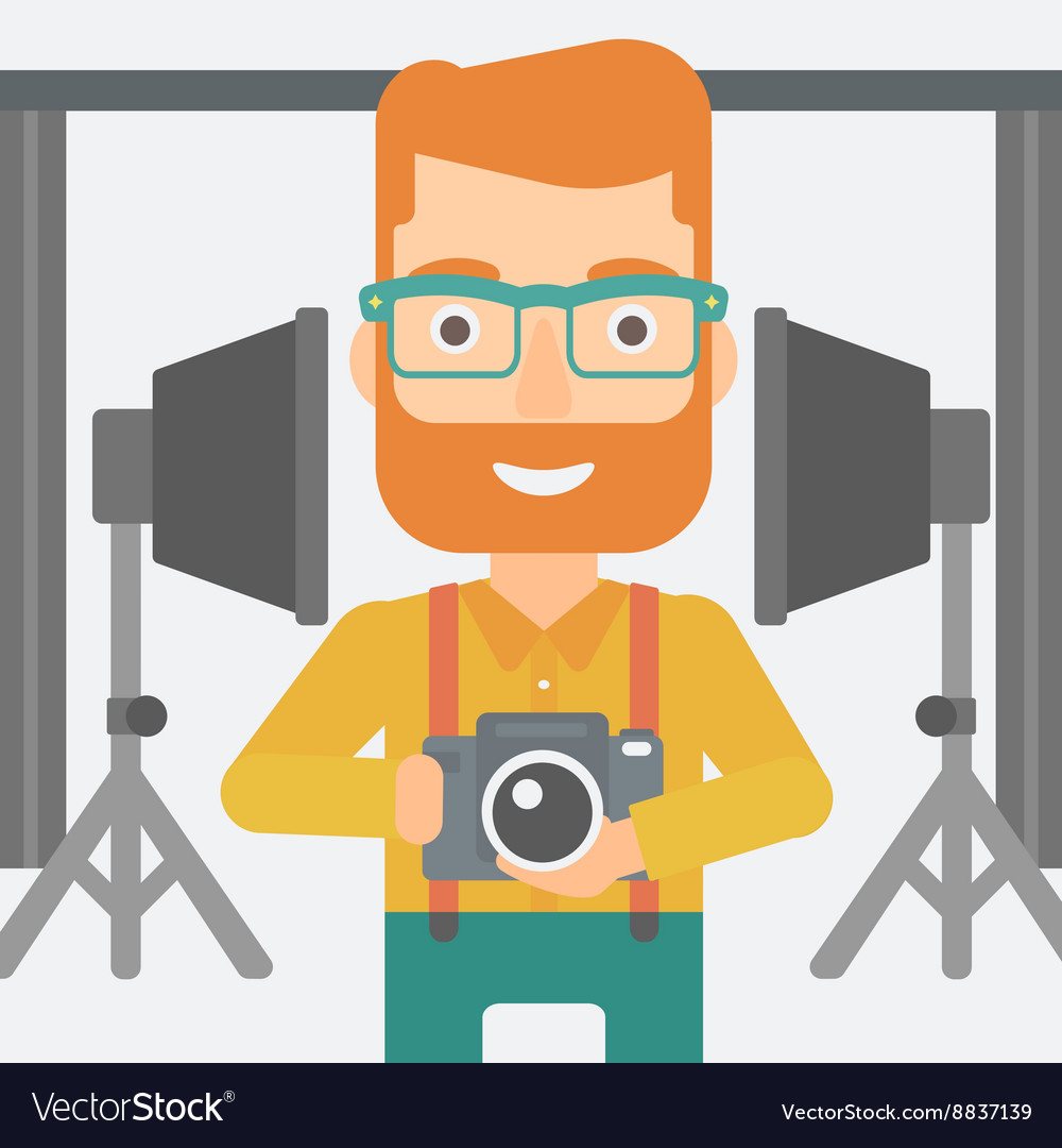 Smiling photographer holding camera