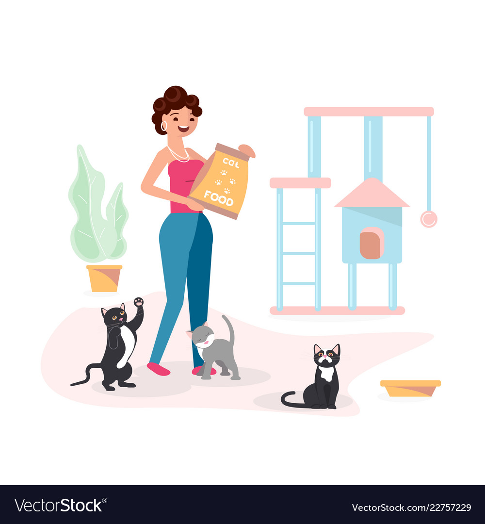 Young woman feeds her cats