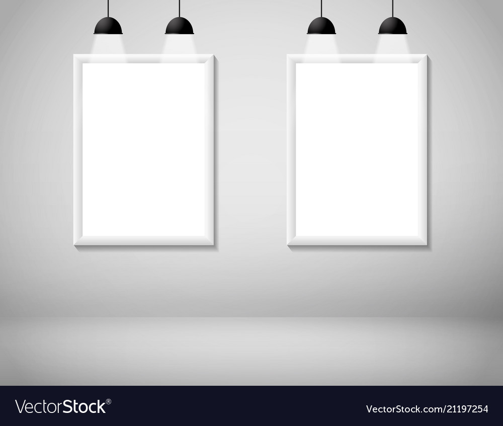 Blank white frame on wall with lamp
