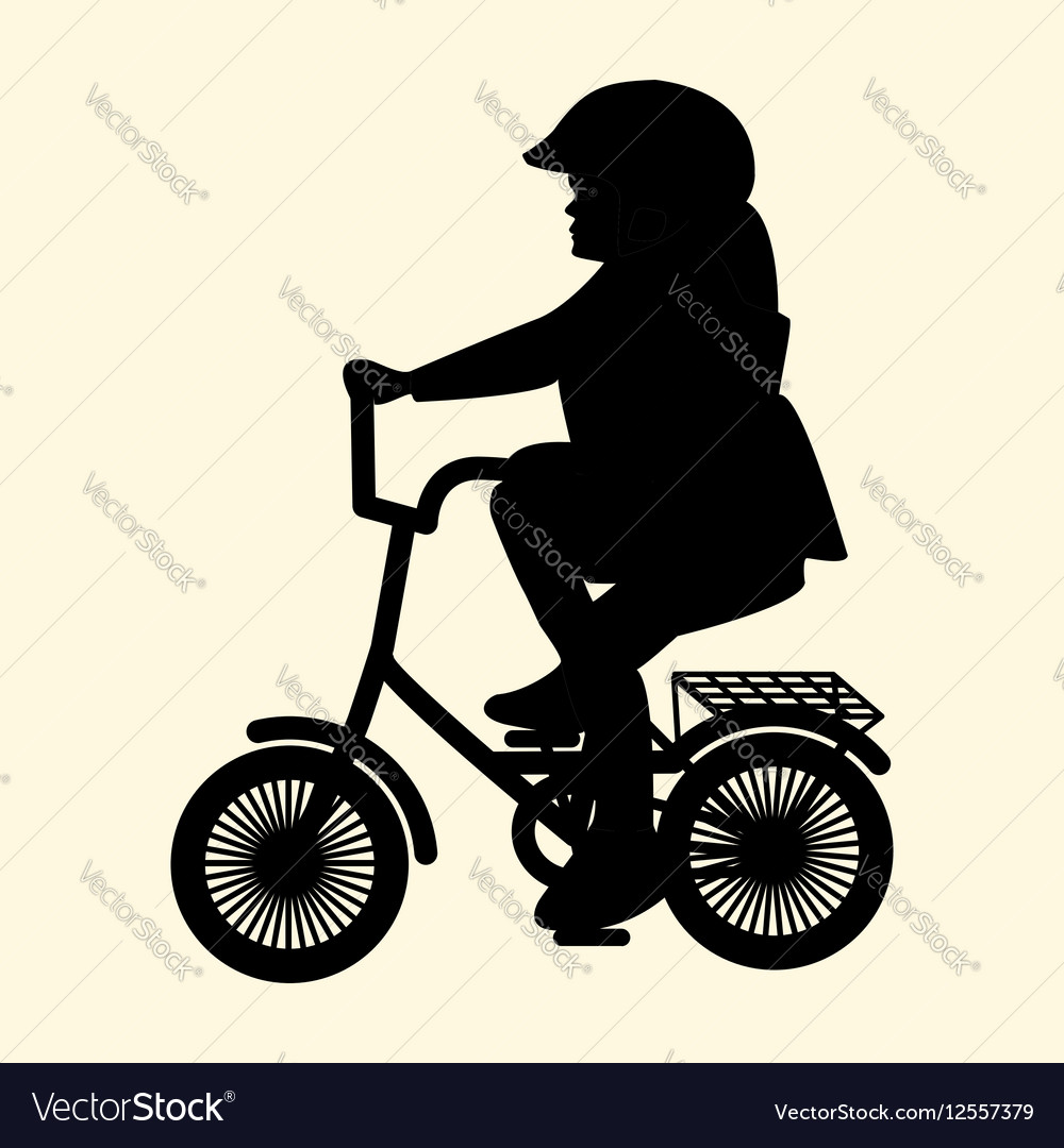 A silhouette of a little girl on a small bicycle