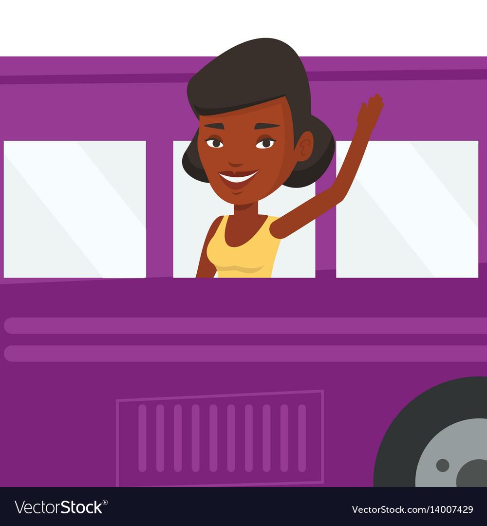 Woman waving hand from bus window
