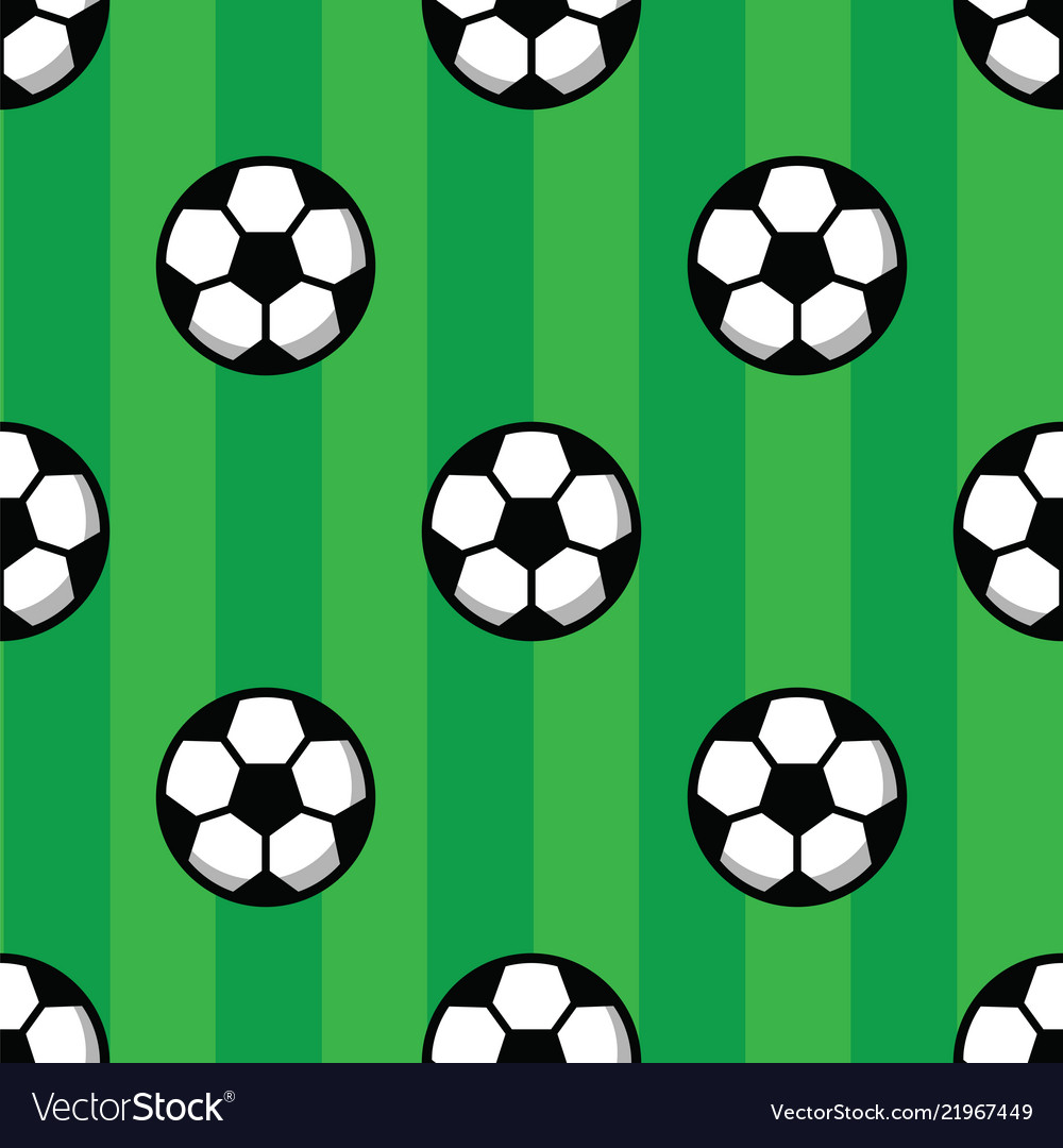 Football balls on green grass of soccer field