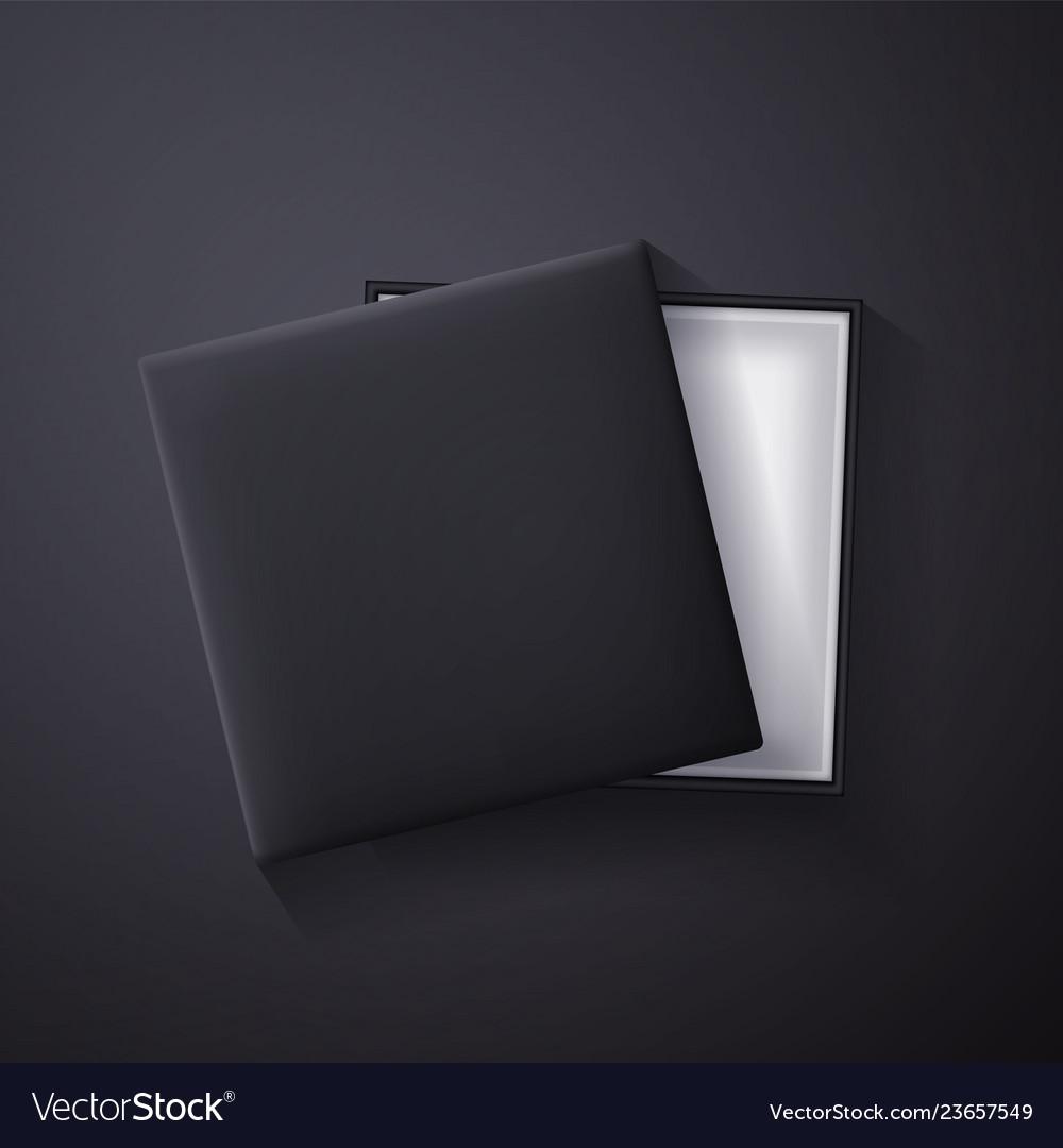 Open black empty gift box on dark background top
