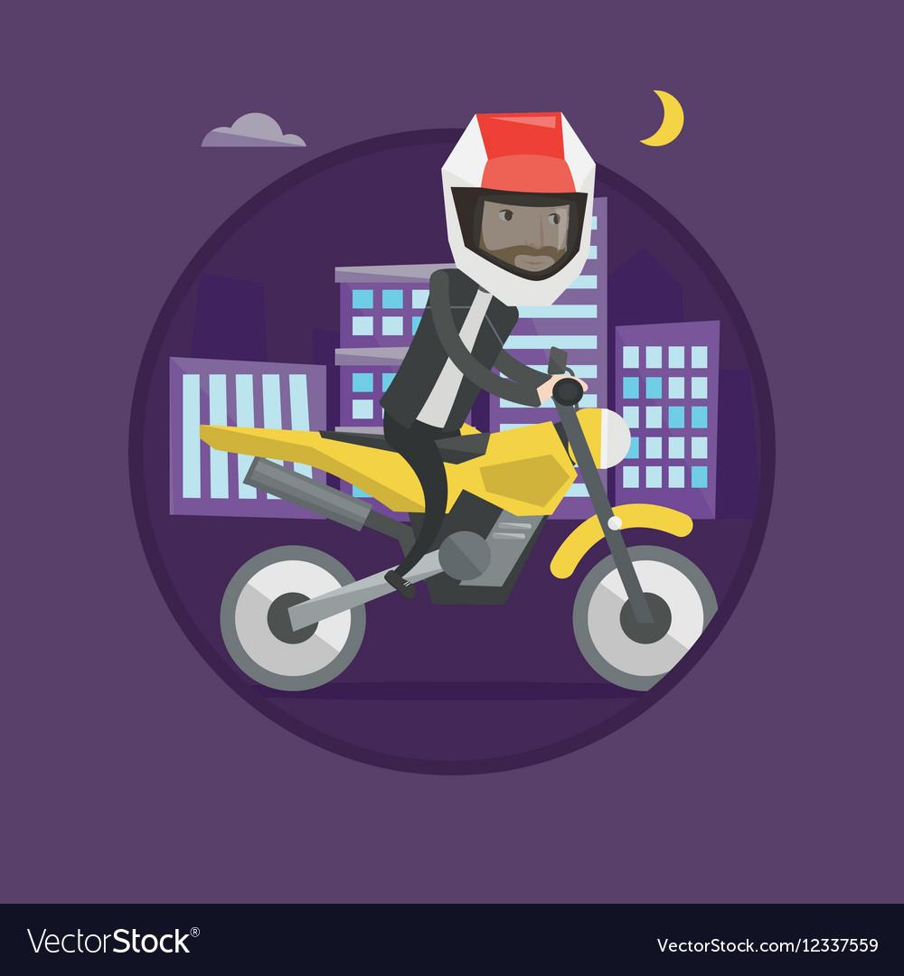 Man riding motorcycle at night