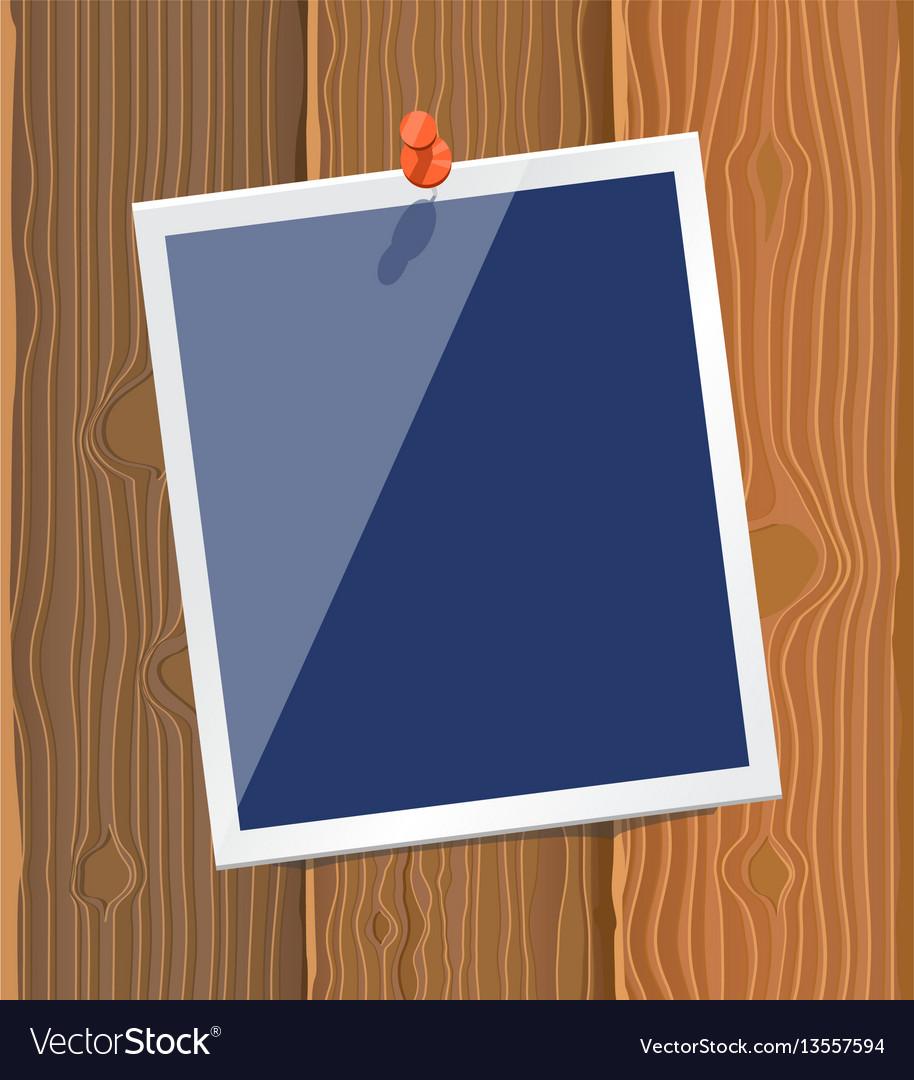 Photo frame on wood texture