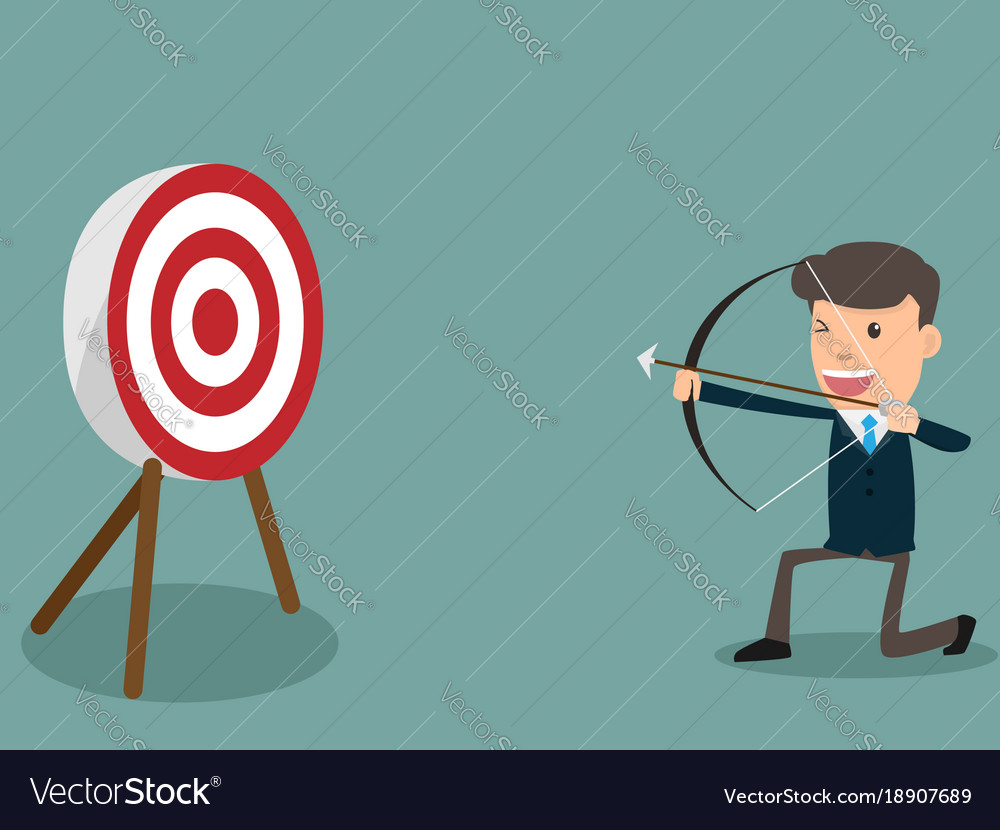 Determined handsome businessman aiming at target