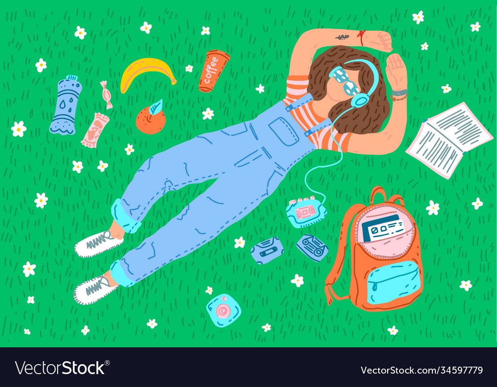 Girl lying on grass dreaming and reading book